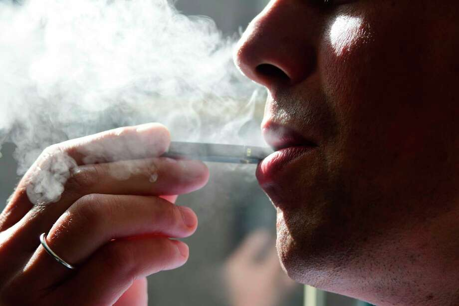 Four new cases of Connecticut residents with lung injuries possibly linked to using e-cigarettes or vaping, have been reported by the state Department of Public Health. It brings the number of case in the state to 38. One patient remains hospitalized. Photo: EVA HAMBACH / AFP /Getty Images / AFP or licensors
