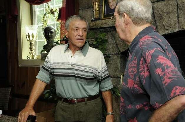 Sam Coppola (right) greets frie...