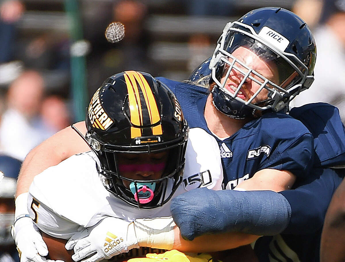 Southern Miss wide receiver Tim Jones, left, is tackled by Rice linebacker Blaze Alldredge during the first half of an NCAA college football game, Saturday, Oct. 26, 2019, in Houston.