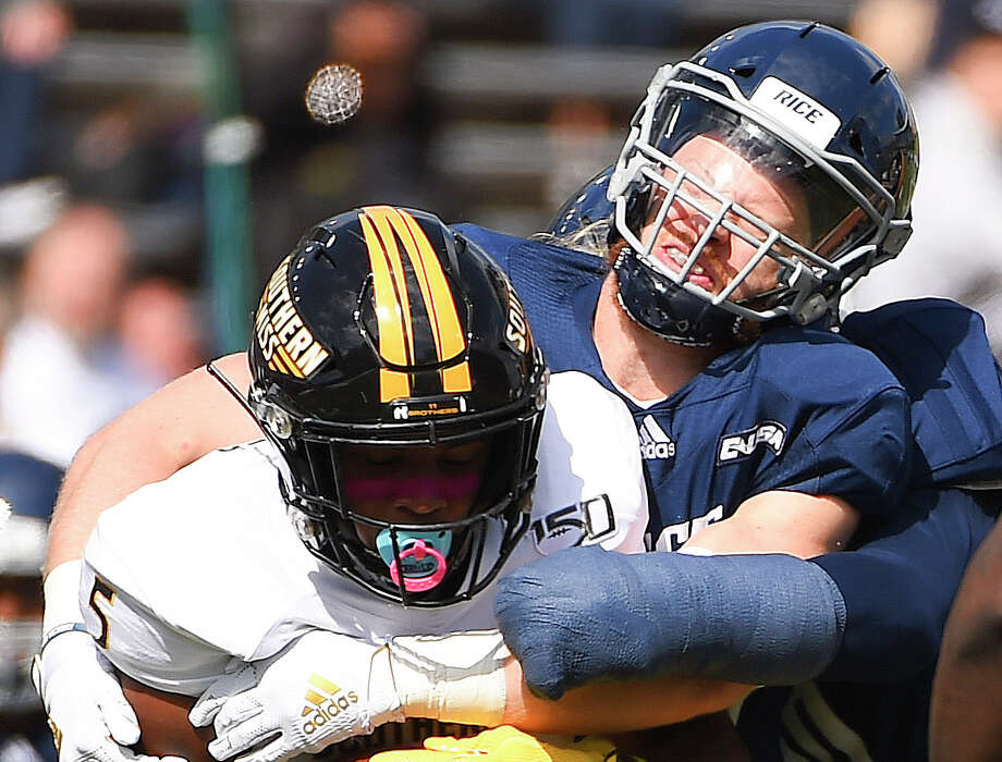 Southern Miss wide receiver Tim Jones, left, is tackled by Rice linebacker Blaze Alldredge during the first half of an NCAA college football game, Saturday, Oct. 26, 2019, in Houston. Photo: Eric Christian Smith/Contributor