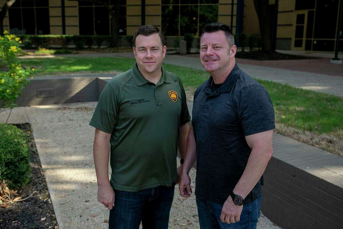 San Antonio Police Officers Joe Smarro, left, and Ernie Stevens pose at San Antonio Police Training Academy in 2019.