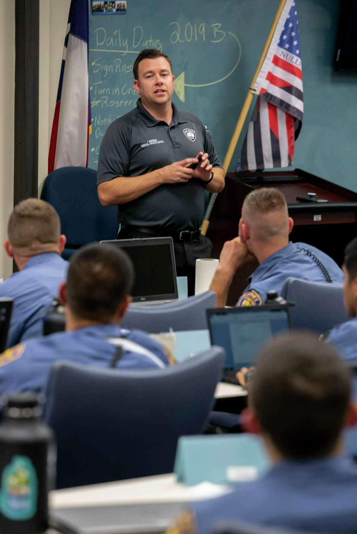 San Antonio Police Officer Joe Smarro talks with cadets during a week-long Crisis Intervention Training program at the San Antonio Police Training Academy. Smarro and Stevens are members of the department's Mental Health Unit.
