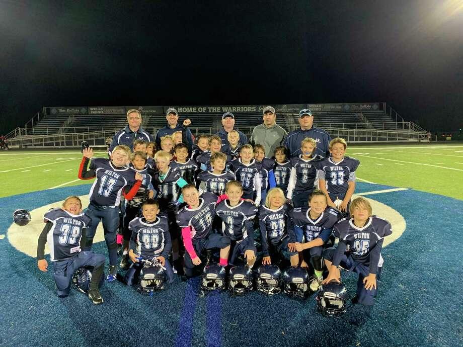 The Wilton 3rd/4th grade team celebrates its unbeaten regular season. Photo: Contributed Photo / Wilton Youth Football