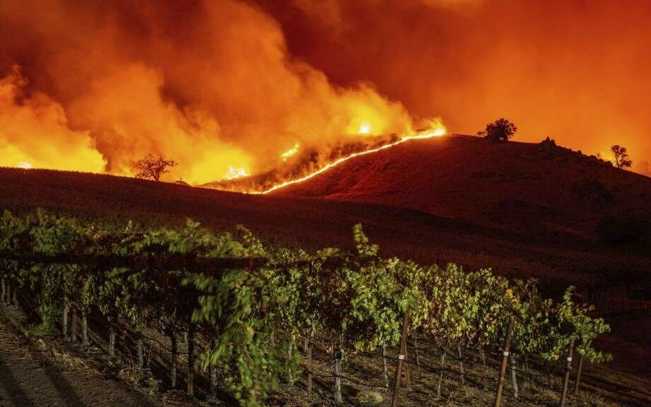The Kincade fire tears through Sonoma wine country. Keep clicking for more photos of the damage. Photo: Josh Edelson/AFP Via Getty Images