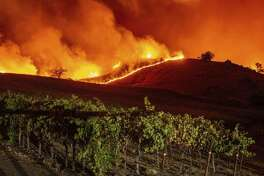 The Kincade fire tears through Sonoma wine country. Keep clicking for more photos of the damage.