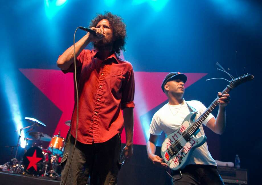 FILE - Zack de la Rocha (L) and Tom Morello of Rage Against The Machine perform at the Hollywood Palladium on July 23, 2010 in Hollywood, California. Rage Against the Machine is reportedly reuniting in 2020 and has booked tour dates in a limited number of states. Photo: Noel Vasquez/Getty Images