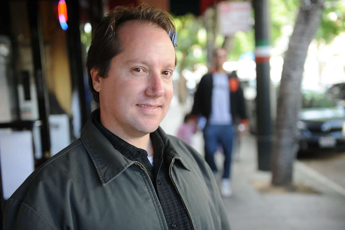 Jon Golinger, president of the Telegraph Hill Dwellers, poses for a photo in North Beach on June 27, 2011. The area is going through a revitalization with several new art galleries, stores and restuarants moving into the area.