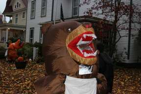 An angry inflatable bear goes door to door in Frankfort on Halloween.