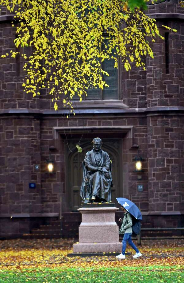 New Haven, Connecticut -Wednesday, October 30, 2019: The statue of Theodore Dwight Woolsey, the President of Yale College from 1846 through 1871, watches over a passerby during a rainy autumn Wednesday on Old Campus at Yale University. Photo: Peter Hvizdak / Hearst Connecticut Media / New Haven Register