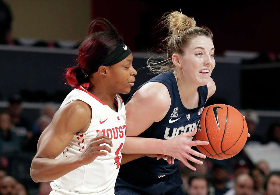 Houston guard Jasmyne Harris, left, defends as Connecticut guard/forward Katie Lou Samuelson (33) drives to the basket during the first half of an NCAA college basketball game Sunday, Jan. 6, 2019, in Houston. (AP Photo/Michael Wyke) Photo: Michael Wyke/Associated Press / Copyright 2019 The Associated Press. All rights reserved.