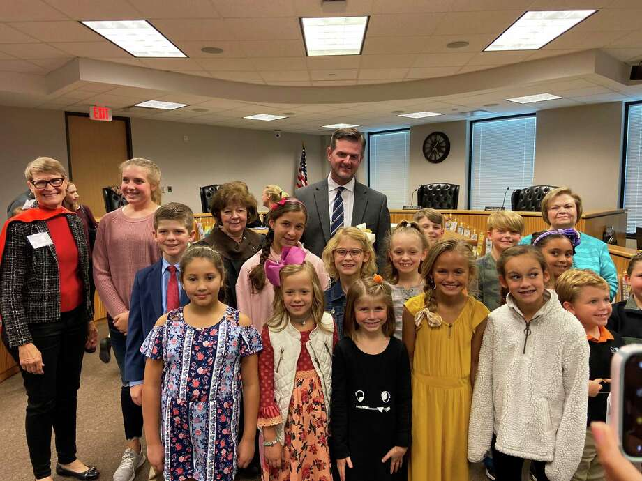 Forty-three local K-8 students, representing 70 schools throughout the county, were recognized and awarded cash prizes in a packed courtroom of teachers, school principals, parents and excited siblings on Oct. 25. As a part of the annual Bookmark Art Contest, The Dispute Resolution Center of Montgomery County received 2,033 bookmark art entries and utilized 39 judges from 19 different organizations to select the 43 winning bookmarks. Sen. Brandon Creighton is pictured with some of the winners. Photo: Courtesy Photo