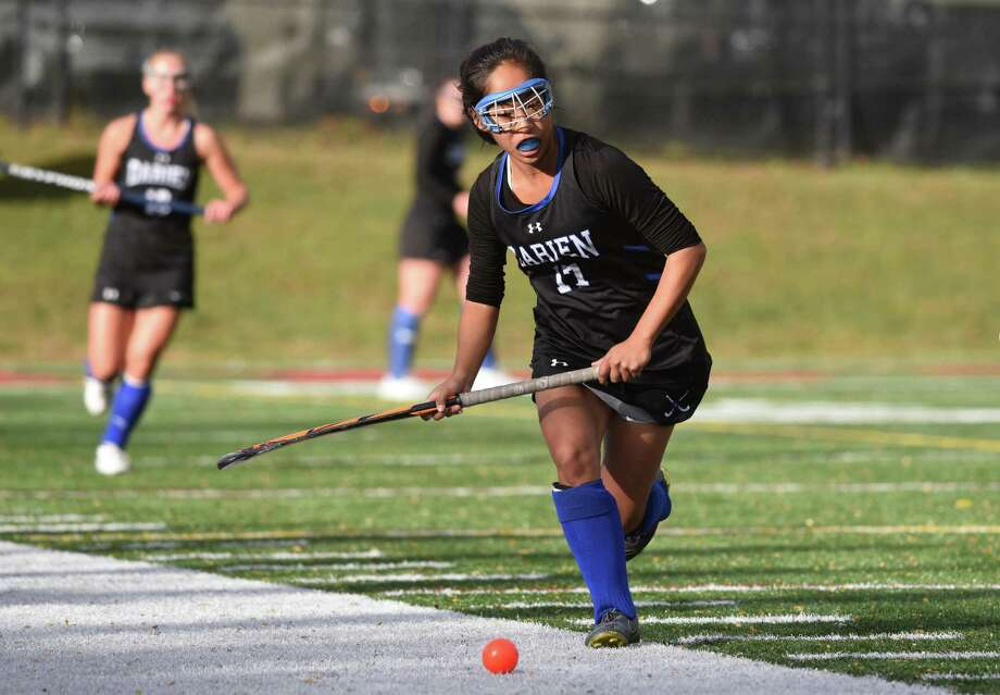 Darien's Tala Garcia (17) controls the ball during a field hockey game at Dunning Field in New Canaan on Friday, Oct. 18, 2019. Photo: Dave Stewart / Hearst Connecticut Media / Hearst Connecticut Media