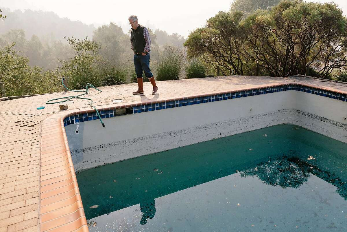 Parke Hafner, owner and winemaker of Hafner Vienyards, looks over a swimming pool on his property that was used by firefighters to fight of the recent encroachment of Kincade Fire, in Healdsburg, California, on Tuesday, Oct. 29, 2019.