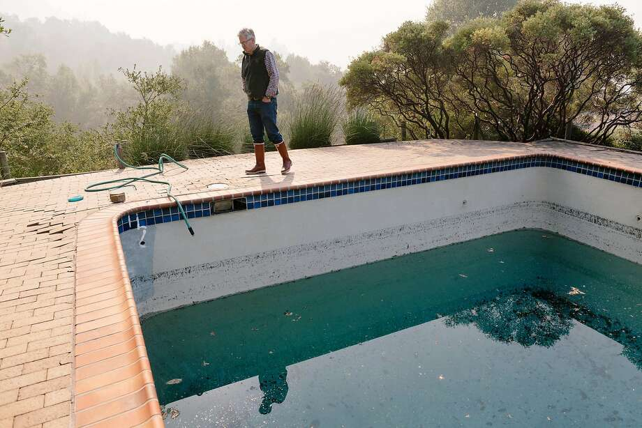 Parke Hafner, owner and winemaker of Hafner Vineyards, looks over a swimming pool on his property that was used by firefighters battling the Kincade Fire. Photo: Michael Short / Special To The Chronicle