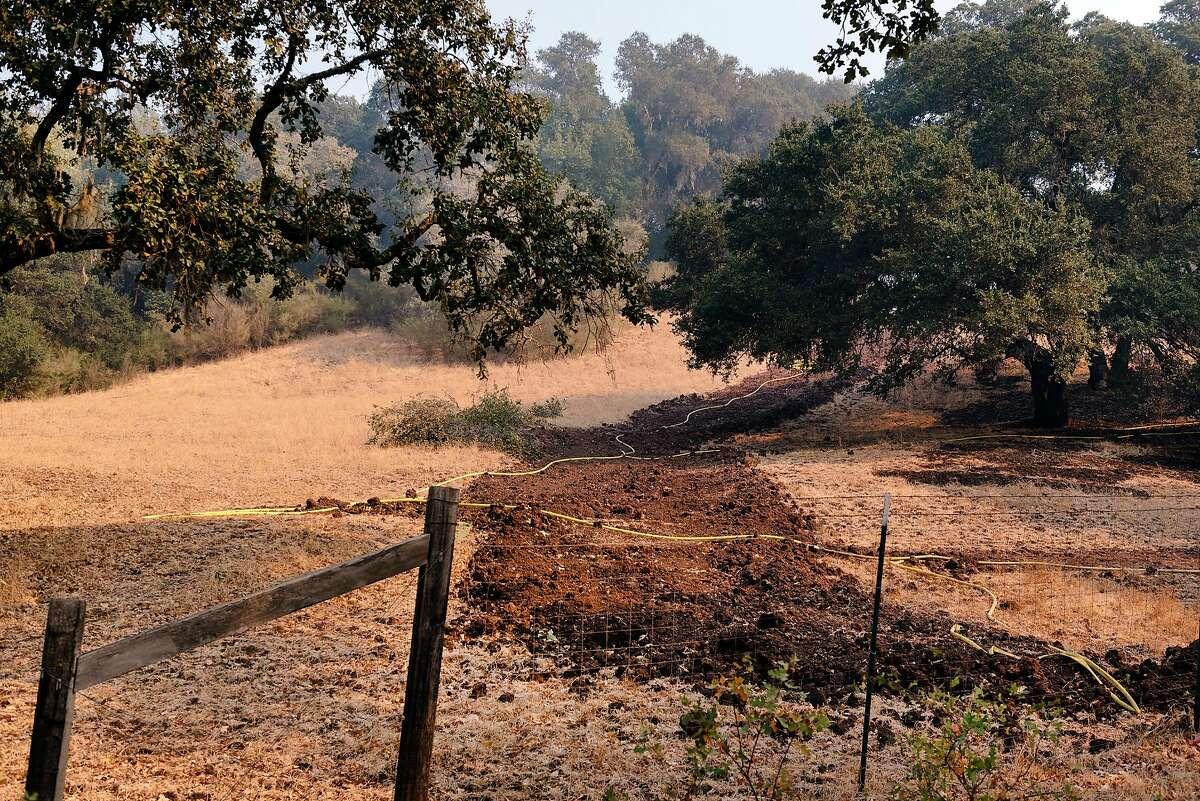 A firebreak cut by firefighters is seen on a hillside at Hafner Vineyards in Healdsburg, California, on Tuesday, Oct. 29, 2019.