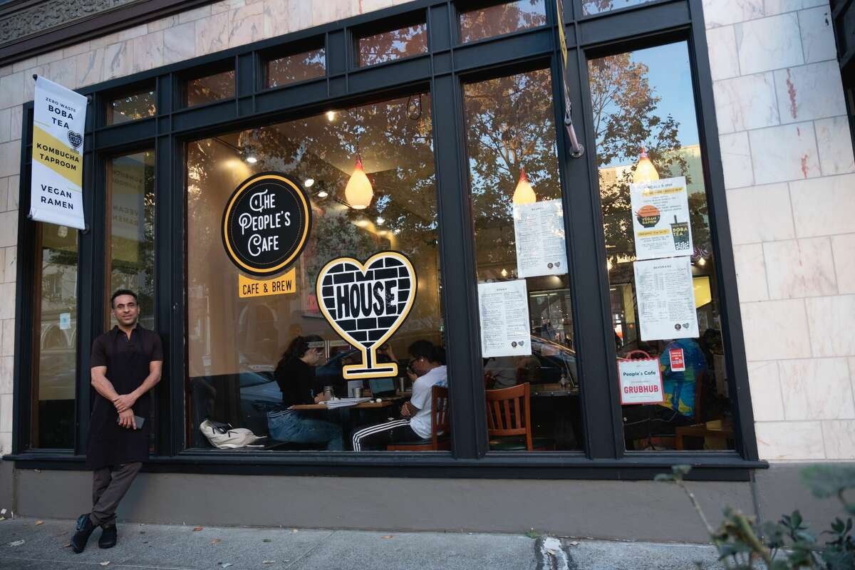 Berkeley's People's Cafe has a new partnership with House Kombucha. At its grand opening on Saturday, Oct. 26, the cafe introduced kombucha on top and other new menu offerings, including vegan ramen and zero-waste boba tea. People's Cafe owner Anson Abdulla stands outside the cafe.