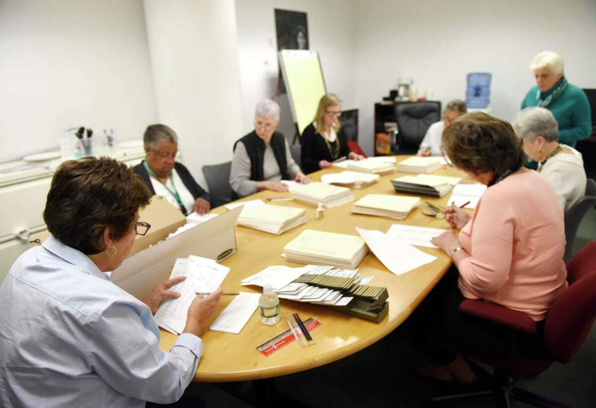 Lucille Limone, left, and other election workers prepare for the upcoming election at the Registrar of Voters office in the Government Center in Stamford, Conn. Thursday, Oct. 31, 2019. Turnout for the election on Nov. 5 is expected to be low as the only offices up for grabs are Board of Finance, Board of Education and one Board of Representatives seat.