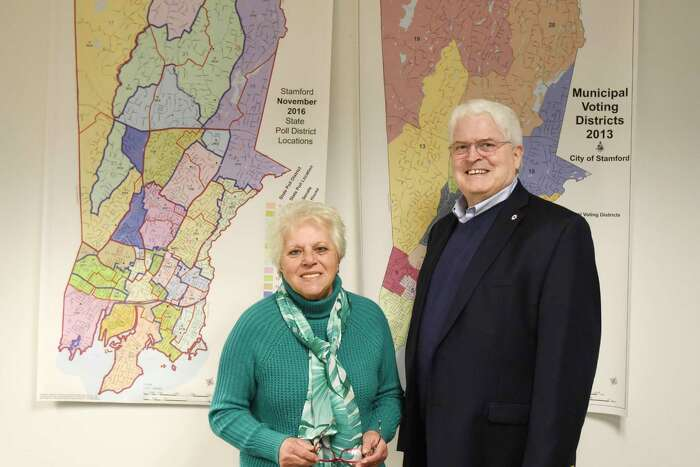 Stamford's Republican Registrar of Voters Lucy Corelli and Democratic Registrar of Voters Ron Malloy pose together at the Registrar of Voters office in the Government Center in Stamford, Conn. Thursday, Oct. 31, 2019. Turnout for the election on Nov. 5 is expected to be low as the only offices up for grabs are Board of Finance, Board of Education and one Board of Representatives seat.