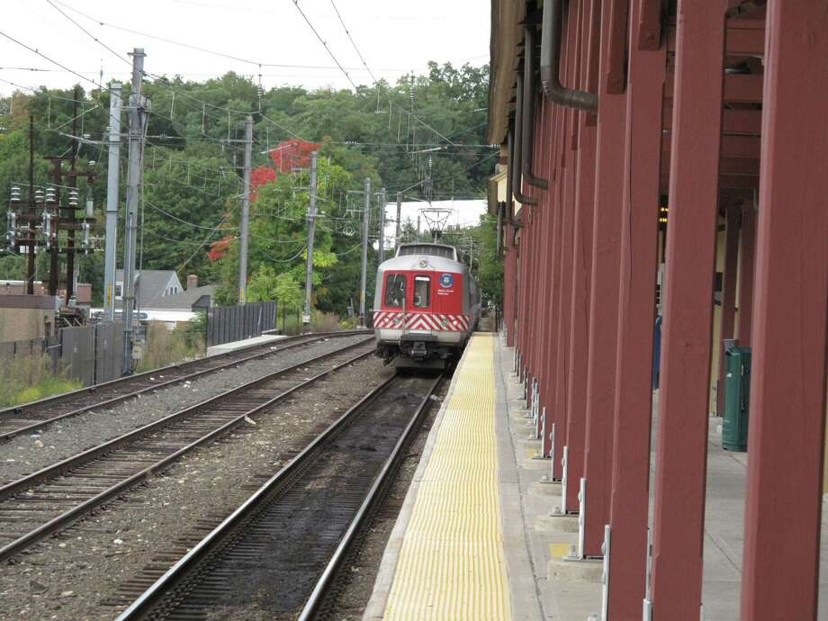 A train arrives at the New Canaan train station in the center of the Town. A downed tree from a storm knocked out train service overnight Thursday into Friday morning. Photo: Tyler Woods / Hearst Connecticut Media Photo: Tyler Woods / Hearst Connecticut Media / New Canaan News
