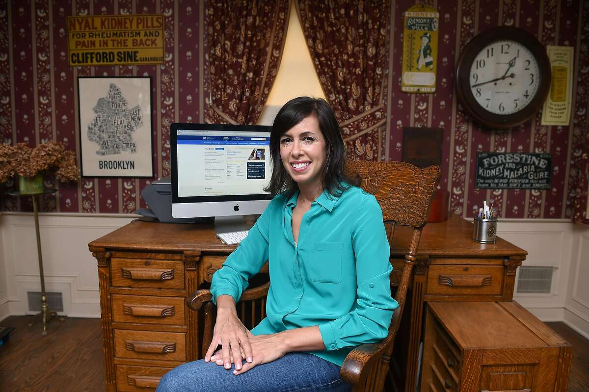 FCC Commissioner Jessica Rosenworcel is photographed in the office of her father at her childhood home in West Hartford on July 22, 2019.