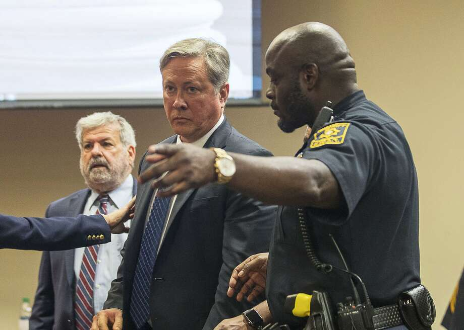 "Robert ""Chip"" Olsen is escorted out of the courtroom in Decatur, Ga., Oct. 14 after he was convicted of aggravated assault, violating his oath of office and making a false statement. Photo: Alyssa Pointer / Atlanta Journal-Constitution"