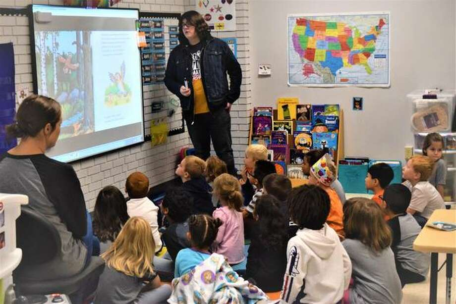 """An Edwardsville High School student reads the English version of """"The Gruffalo"""" to students at Nelson Elementary School on Friday. Photo: Tyler Pletsch 