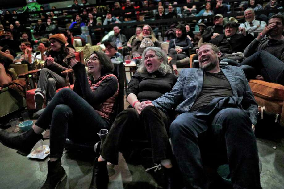 Sarah Tanquary, left, Donna Morton, center, Frank Connolly, right, laughing at the speech by Olivia Coleman after she won the Academy Award for Best Actress during an Oscars Night Party at the New Parkway Theater in Oakland, Calif., Feb. 24. What's considered humorous is different for everyone, but humor is a big part of life. Photo: Carlos Avila Gonzalez /The Chronicle / ONLINE_YES
