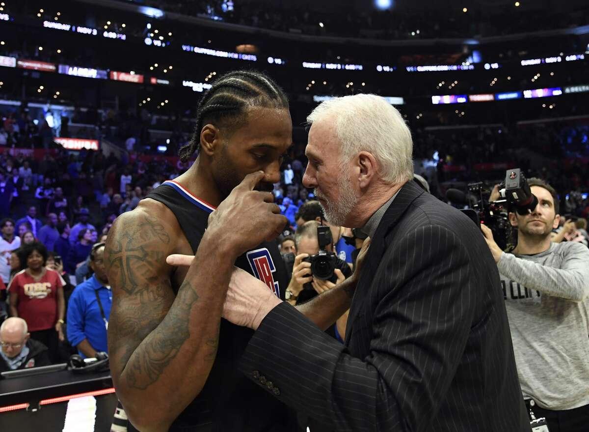 Los Angeles Clippers forward Kawhi Leonard (2) talks with San Antonio Spurs head coach Gregg Popovich after a NBA game between the San Antonio Spurs and the Los Angeles Clippers on October 31, 201,9 at STAPLES Center in Los Angeles.