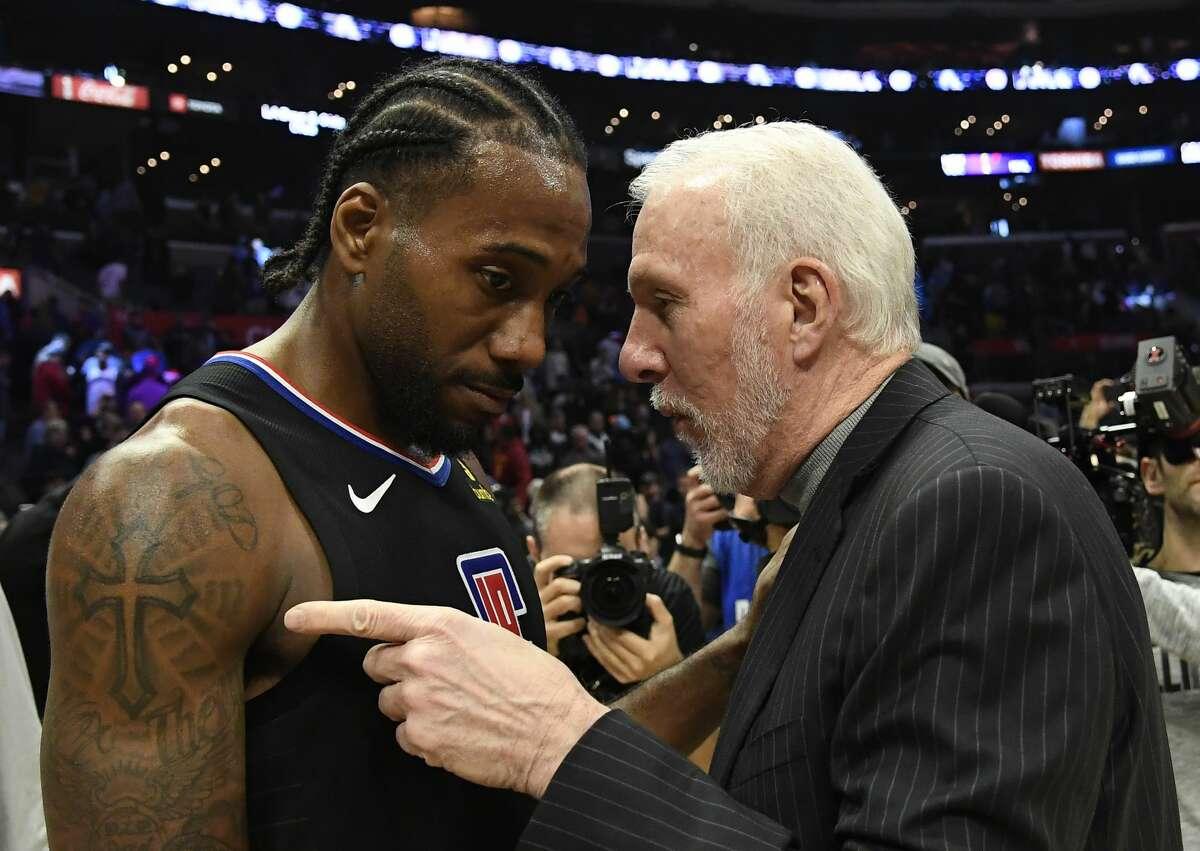 Los Angeles Clippers forward Kawhi Leonard (2) talks with San Antonio Spurs head coach Gregg Popovich after a NBA game between the San Antonio Spurs and the Los Angeles Clippers on October 31,...