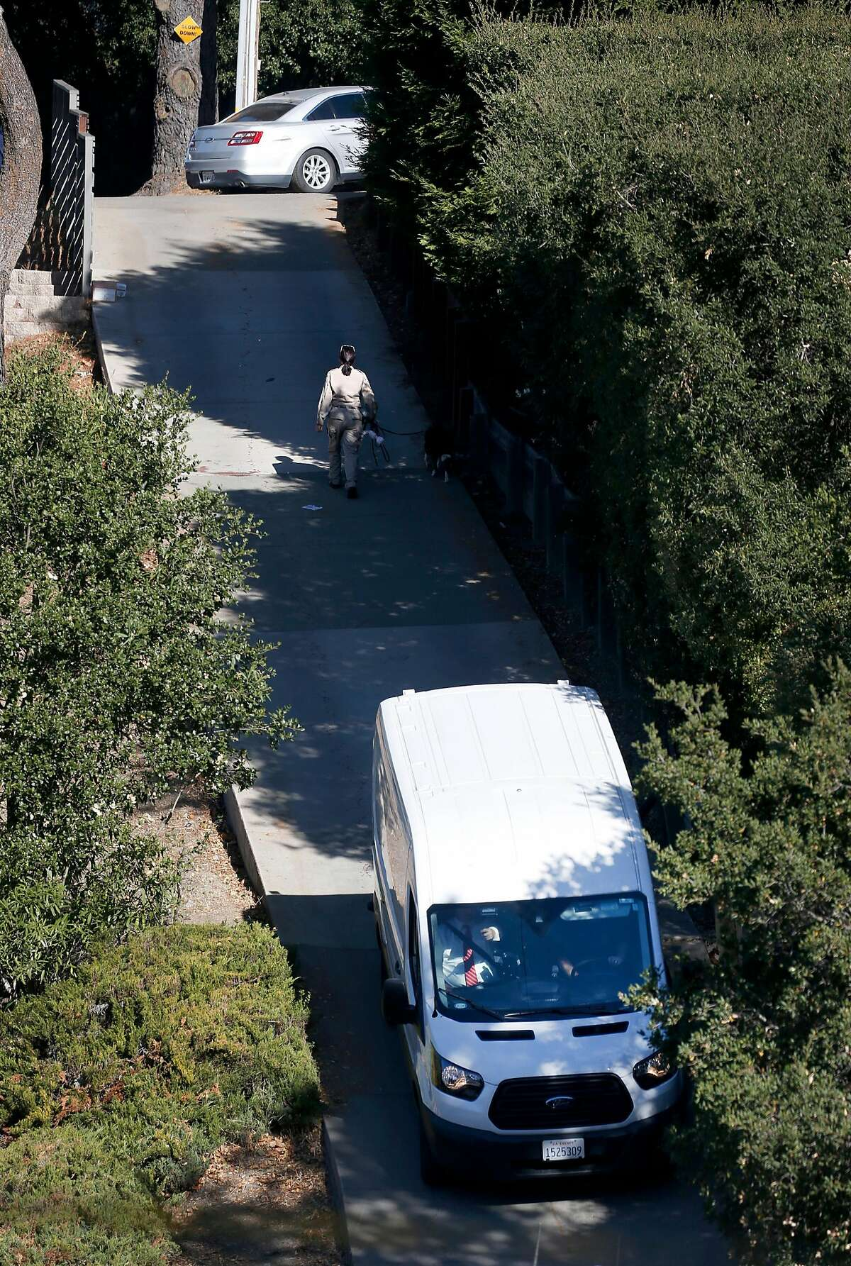 A Contra Costa County coroner's van leaves from a home on Lucille Way in Orinda, Calif. on Friday, Nov. 1, 2019 after four people were killed and several left injured in a shooting during a Halloween party Thursday night.
