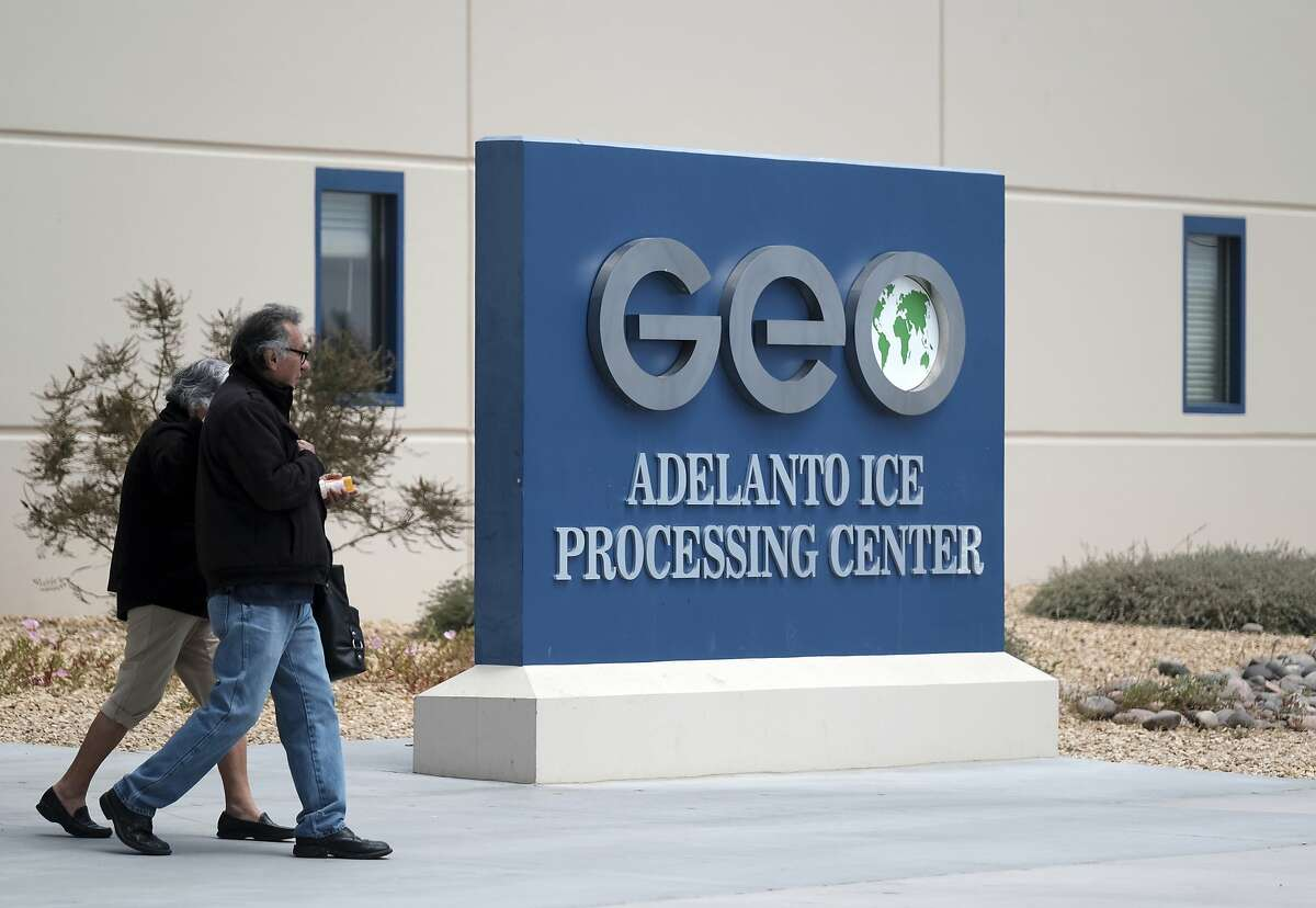 This April 20, 2019 file photo shows the U.S. Immigration and Enforcement Processing Center operated by GEO Group, Inc. (GEO) a Florida-based company specializing in privatized corrections in Adelanto, Calif. California is banning the use of for-profit, private detention facilities, including those the federal government uses for immigrants awaiting deportation hearings. California Gov. Gavin Newsom announced Friday, Oct. 11, 2019 he had signed a measure into law that helps fulfill his promise to end the use of private prisons. (AP Photo/Richard Vogel, File)