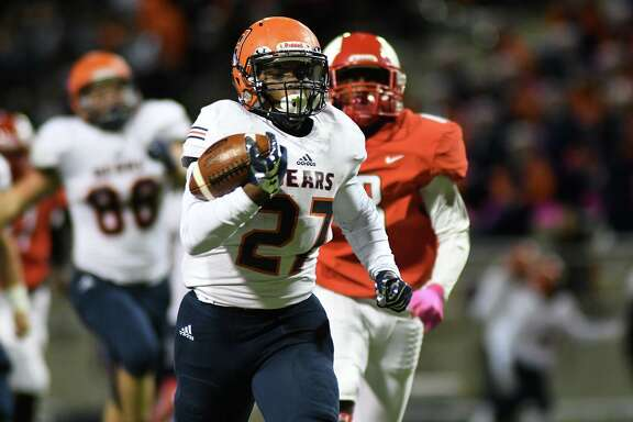 Bridgeland sophomore running back Mason Culton (27) breaks free from Day'shan Hall, right, and the Spartans defense for a touchdown run in the first quarter of their District 14-6A matchup at Cy-Fair FCU Stadium in Cypress on Oct. 31, 2019.