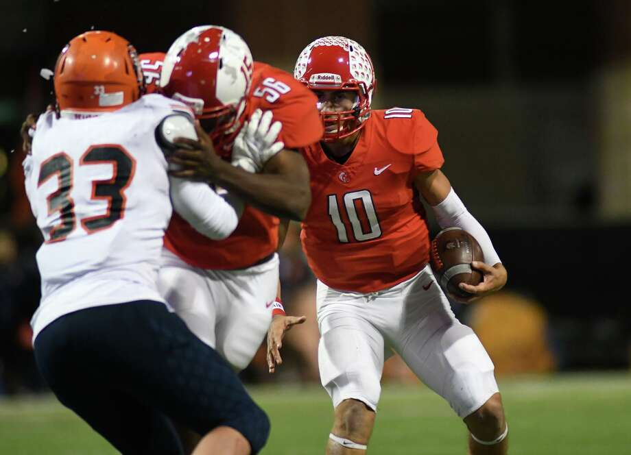 Cy Lakes senior quarterback Sofian Massoud, right, looks to make a play against junior linebacker Conner Motsinger (33) and the Bridgeland defense in the second quarter of their District 14-6A matchup at Cy-Fair FCU Stadium in Cypress on Oct. 31, 2019. Photo: Jerry Baker, Houston Chronicle / Contributor / Houston Chronicle