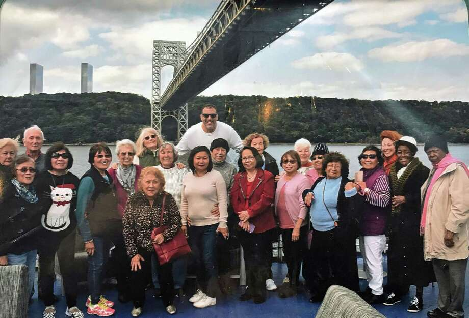 Memnbers of CCI's seniors program posed for a photo on a New York City cruise last fall. The group is expected to attend again in November. Photo: Contributed / Contributed Photo / Greenwich Time contributed