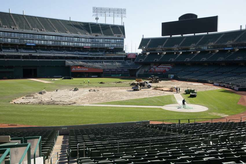 Groundskeepers for the Oakland A's convert the field of the Oakland Coliseum from a baseball to a football field.