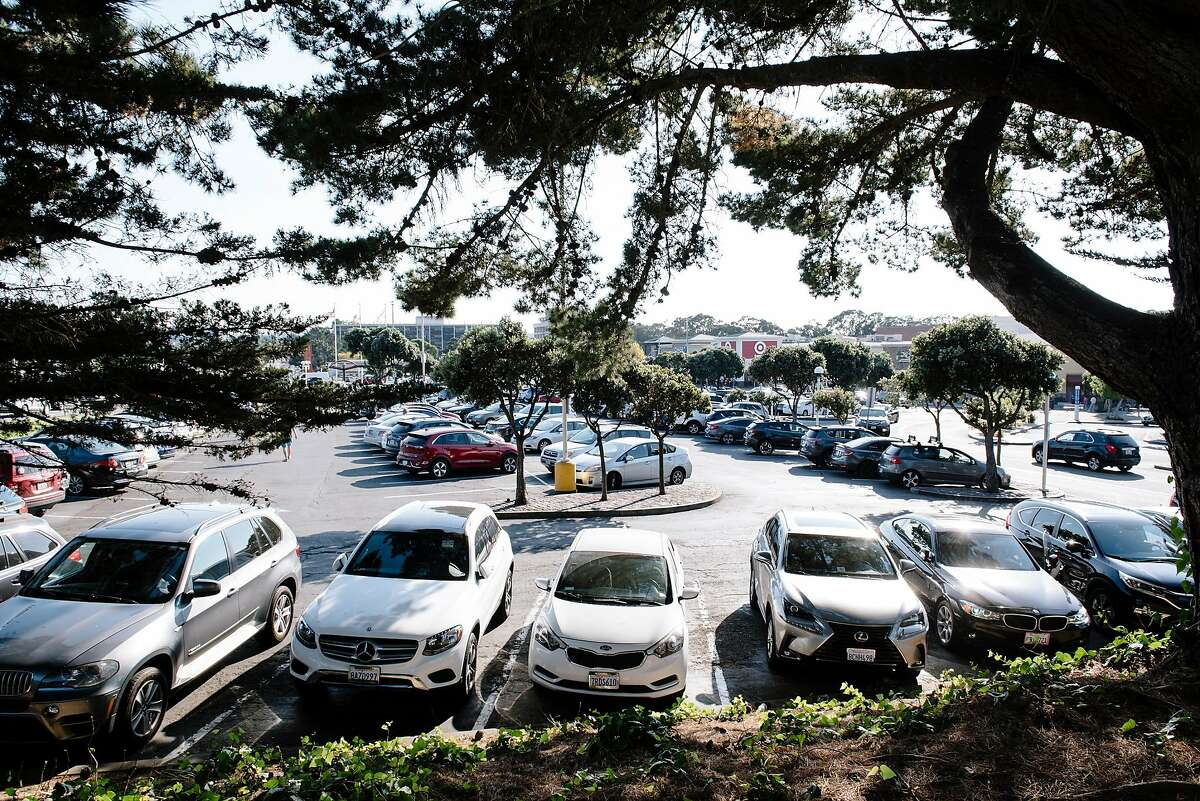 Cars fill the outdoor parking lot at the Stonestown Galleria in San Francisco, California, on Friday, Oct. 25, 2019. The new ownership of the Stonestown Galleria are discussing potential housing development on portions of the mall property.