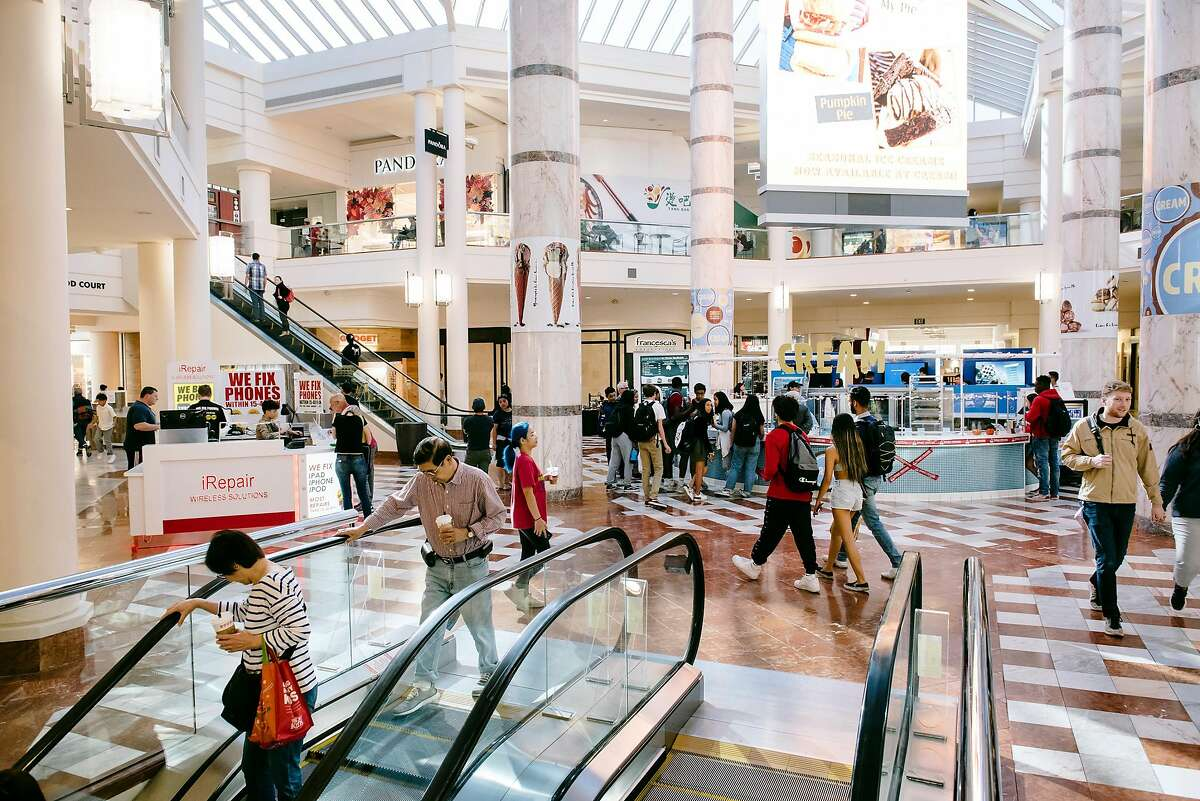 Shoppers are seen at the Stonestown Galleria in San Francisco, California, on Friday, Oct. 25, 2019. The new ownership of the Stonestown Galleria are discussing potential housing development on portions of the mall property.