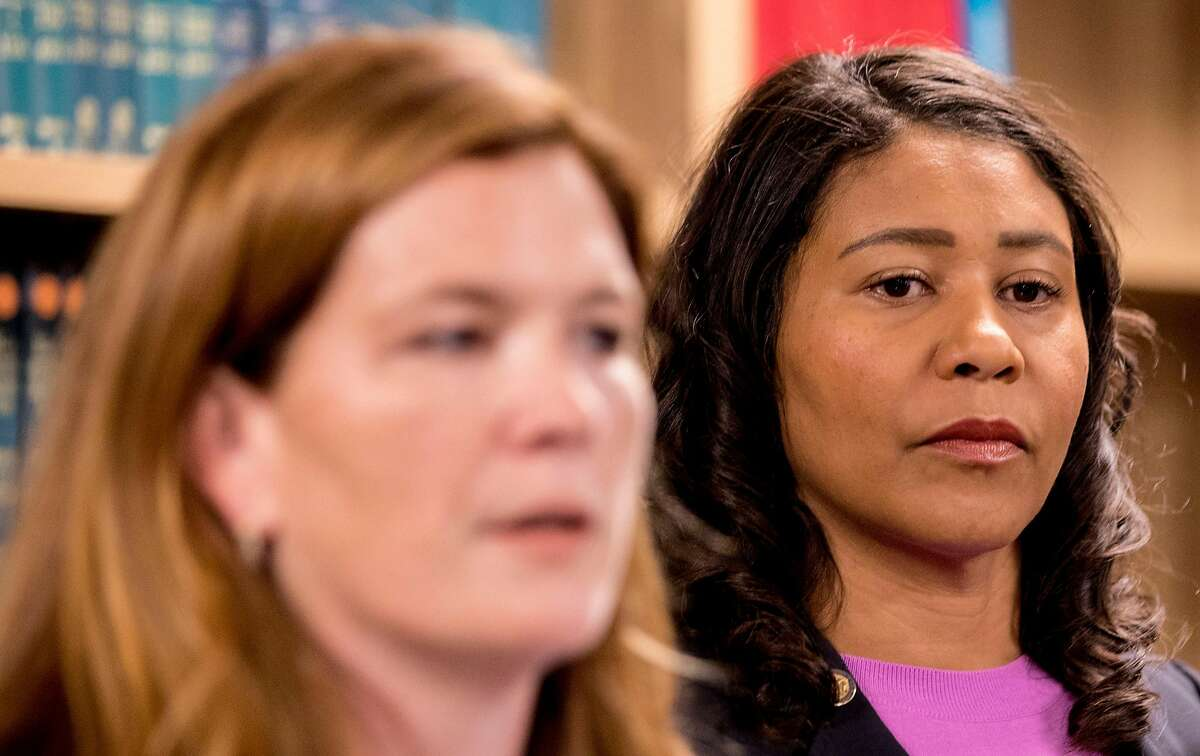 San Francisco Mayor London Breed (right) listens as San Francisco District Attorney candidate Suzy Loftus speaks after being sworn in as interim San Francisco District Attorney at the District Attorney's office in San Francisco, Calif. Saturday, Oct. 19, 2019.