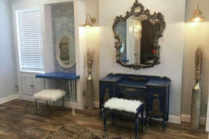 WOW On Broadway's deluxe salon-style Bridal Suite, which includes a bedroom with a fireplace and view of the Mississippi River; open space with six bridesmaids' vanities and a central oversized bride's vanity; and, an elegant ensuite bathroom with a double vanity and claw-foot tub.