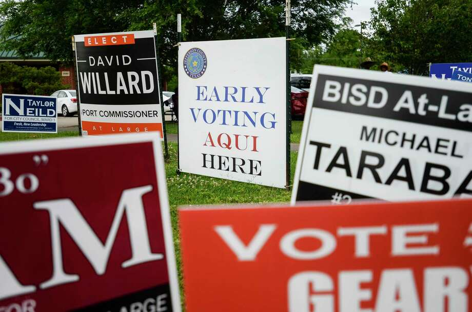 Signs line the road outside of Judge John Paul Davis Community Center Tuesday as people vote early in the area's elections. Photo taken on Tuesday, 04/3019. Ryan Welch/The Enterprise Photo: Ryan Welch, Beuamont Enterprise / The Enterprise / © 2019 Beaumont Enterprise
