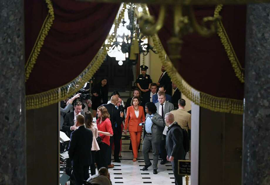 House Speaker Nancy Pelosi, D-Calif., center, walks through the Capitol following a vote on a resolution that provides procedural guidelines for the impeachment inquiry on Oct. 31, 2019. MUST CREDIT: Washington Post photo by Matt McClain Photo: Matt McClain, The Washington Post / The Washington Post / The Washington Post