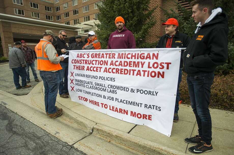 "Members of local chapters of the Laborers' International Union of North America gather Friday, Nov. 1, 2019 for a protest in front of the H Hotel to bring attention to what they called an ""unsafe and unaccredited training program in local high schools."" Organized by the group ""ABC Truth,"" the time and place of the protest coincided with a dinner ceremony taking place at the H Hotel, at which the Associated Builders and Contractors Greater Michigan Chapter (ABC) honored five ""Champions of ABC's Trifecta."" (Katy Kildee/kkildee@mdn.net) Photo: (Katy Kildee/kkildee@mdn.net)"