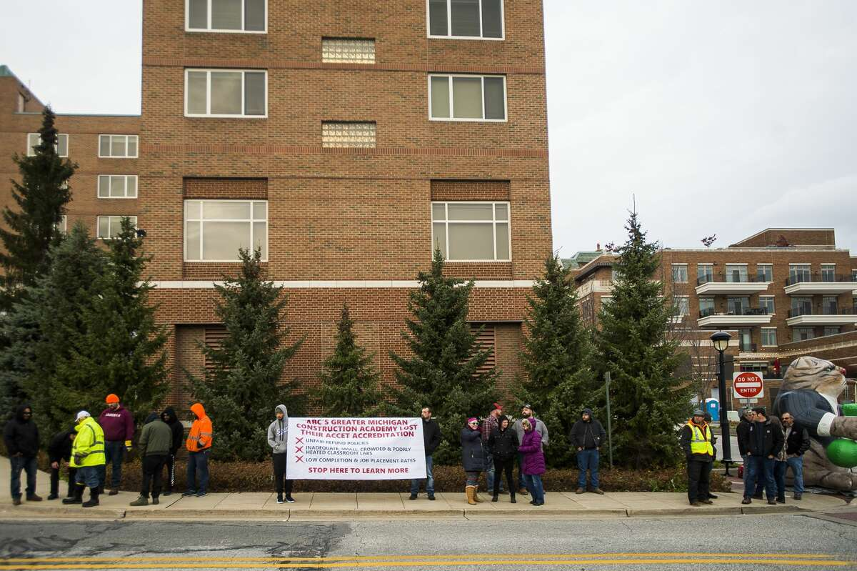 """Members of local chapters of the Laborers' International Union of North America gather Friday, Nov. 1, 2019 for a protest in front of the H Hotel to bring attention to what they called an """"unsafe and unaccredited training program in local high schools."""" Organized by the group """"ABC Truth,"""" the time and place of the protest coincided with a dinner ceremony taking place at the H Hotel, at which the Associated Builders and Contractors Greater Michigan Chapter (ABC)honored five """"Champions of ABC's Trifecta."""" (Katy Kildee/kkildee@mdn.net)"""