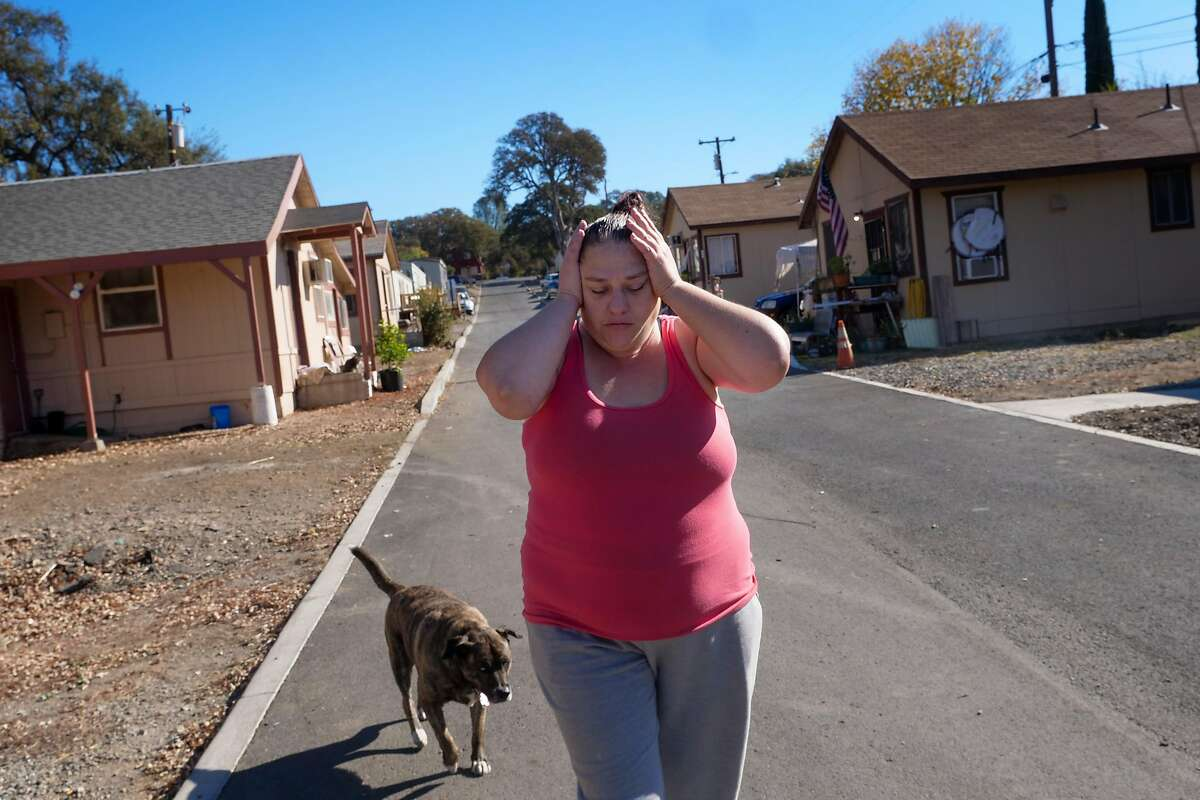 Beth Brackett, 45 years old, reacts as she remembers being without power as she walks to the lake outside her home, Friday November 1, 2019, in Clearlake, CA.