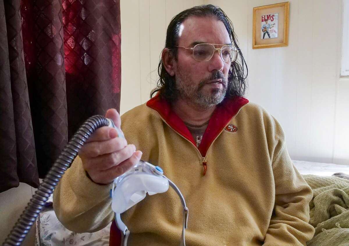 David Jones, 53 years old, fulls off his cpap machine which he went without during the power outage, at his home, Friday November 1, 2019, in Clearlake, CA. More than 100,000 people receiving food assistance had their power shutoff in PG&E's planned blackout Oct. 9, a Chronicle analysis of state data found, raising concerns that Northern California's most economically disenfranchised residents may bear the brunt of the utility's controversial fire prevention plan.