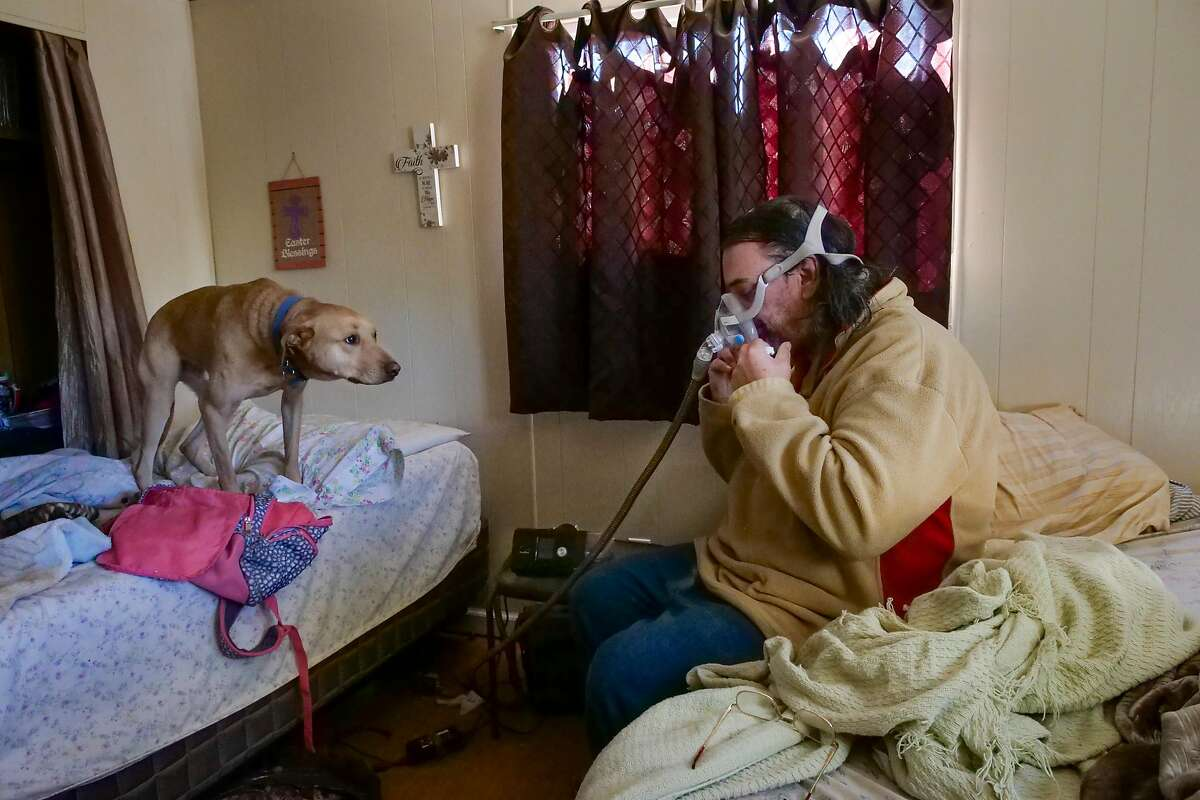 David Jones, 53 years old, pulls off his cpap machine which he went without during the power outage, at his home, Friday November 1, 2019, in Clearlake, CA.