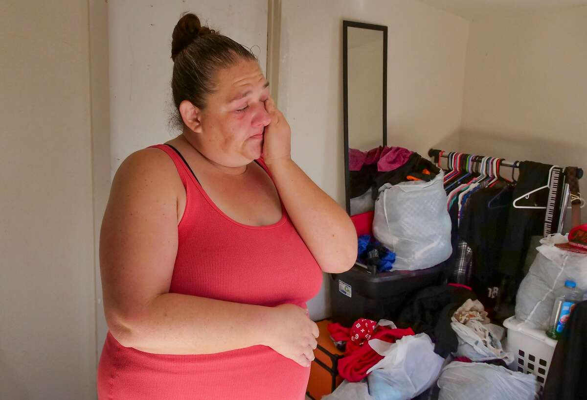 Beth Brackett, 45 years old, cries at her home, Friday November 1, 2019, as she talks of a neighbor whose wife died because she ran out of oxygen as a result of the power outage in Clearlake, CA. More than 100,000 people receiving food assistance had their power shutoff in PG&E's planned blackout Oct. 9, a Chronicle analysis of state data found, raising concerns that Northern California's most economically disenfranchised residents may bear the brunt of the utility's controversial fire prevention plan.