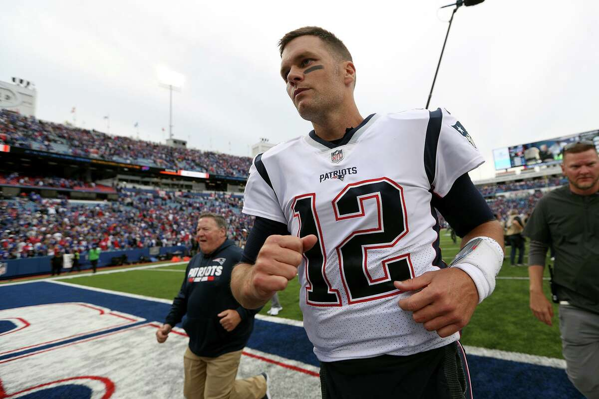Tom Brady (12) of the New England Patriots runs off the field after a game against the Buffalo Bills at New Era Field on Sept. 29, 2019 in Orchard Park, N.Y. (Bryan M. Bennett/Getty Images/TNS)