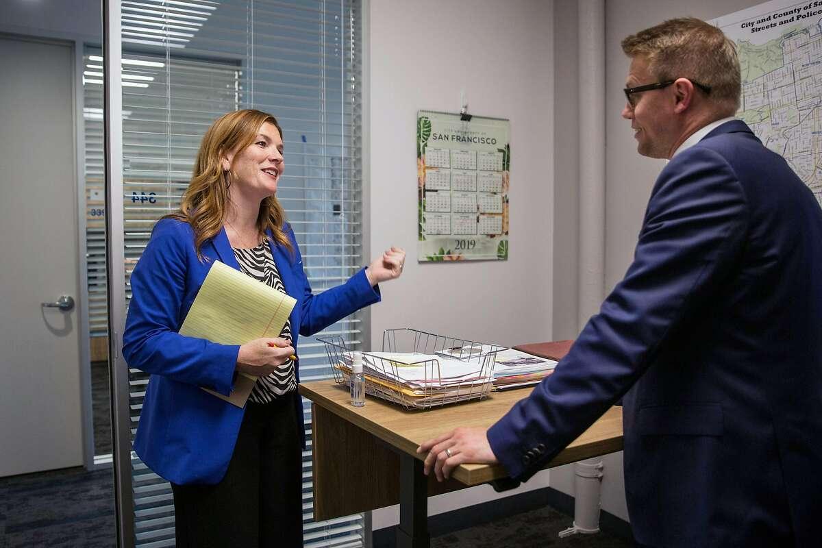 Suzy Loftus, interim District Attorney of San Francisco talks to Aaron Laycook, Assistant District Attorney, at the District Attorney's office on Potrero Hill. Wednesday, October 30, 2019. San Francisco, Calif.