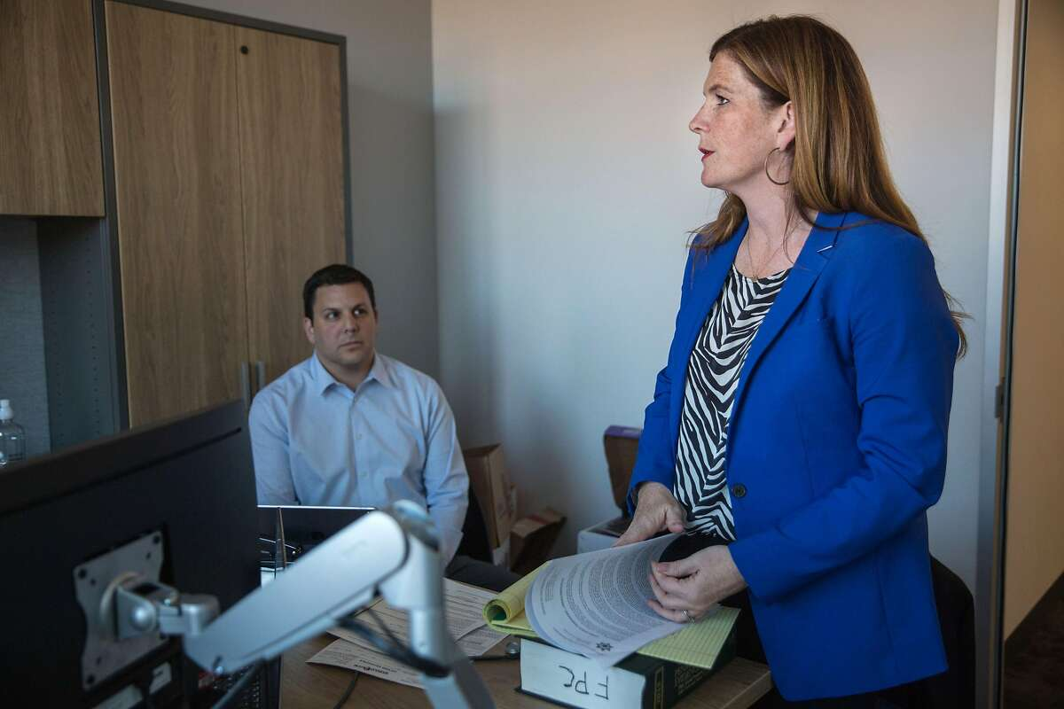 Suzy Loftus, interim District Attorney of San Francisco talks to Sean Connolly, Chief of Crime Strategy Unit and Neighborhood Prosecutors Program, not pictured, and Myles Campbell, Assistant District Attorney, at the District Attorney's office on Potrero Hill. Wednesday, October 30, 2019. San Francisco, Calif.